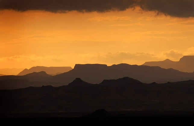 The sun goes down behind the thunderstorm that tried to drown us at Terlingua Creek. The layers of mountains and the color palette made this image my favorite of the trip.