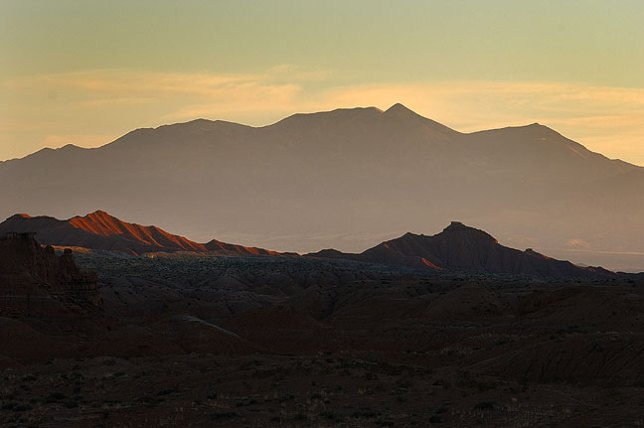 Last light lines the Henry Mountains from Goblin Valley.