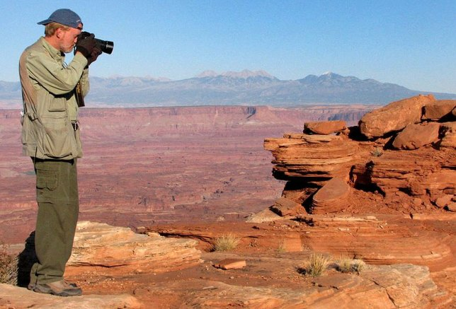 You host makes pictures at the White Rim Overlook in Canyonlands National Park.