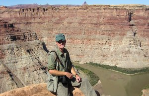 Your host poses at the end of the Confluence Overlook at Canyonlands.
