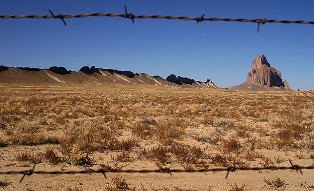 Barbed wire and Shiprock Peak, New Mexico.