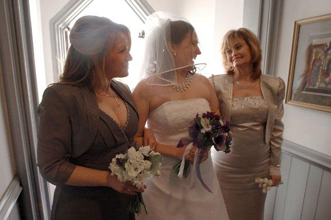 Kim, Chele and Abby enter the Church.