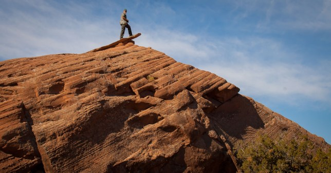"Your host poses on a formation called ""The Diving Board"" at Sand Flats Recreation Area east of Moab, Utah."