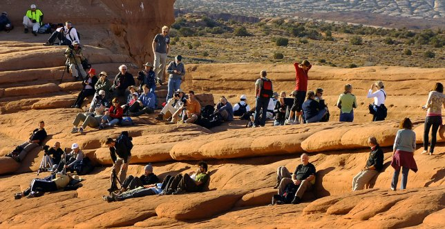 Photographers of all stripes line up to make pictures of Delicate Arch.