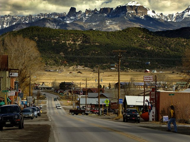 Looking down the main highway in Ridgeway, the first peaks of the spectacular San Juan Mountains appear in the distance.