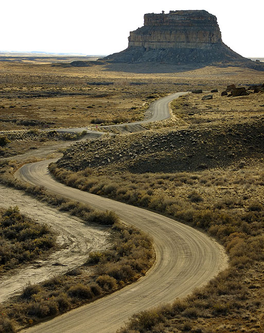 "This view from the overlook trail shows the road to the Gallo Campground, the main road into the park, and Fajada Butte, one of the park's signature features. On this trip I learned that Fajada means ""belt"" or ""banded."""