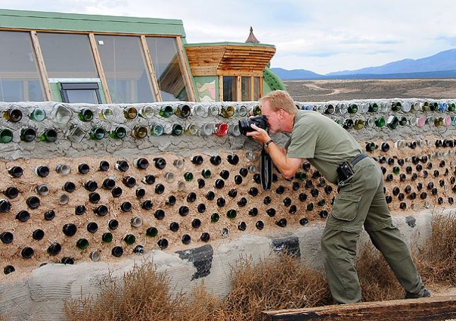 Richard makes pictures of a wall at one of the Earth Ship homes near Tres Piedras, New Mexico.