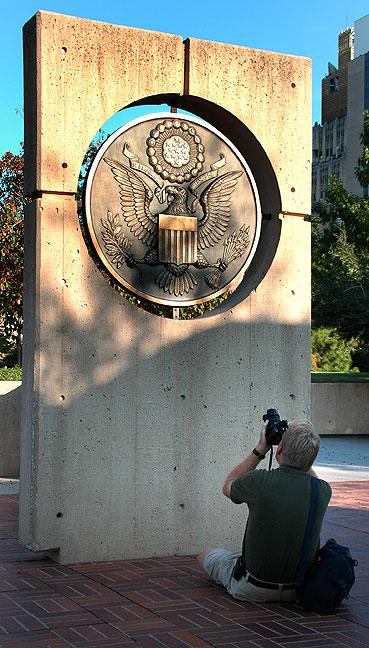 Richard photographs a bronze medallion on the Murrah Building foundation (Photo by Abby S. M. Barron).