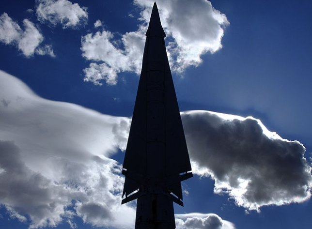 The Nike Hercules missile profiled against a turbulent morning sky.
