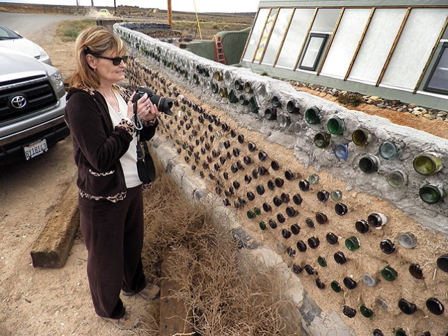 Abby makes pictures at the home of the Earthship Houses in New Mexico.
