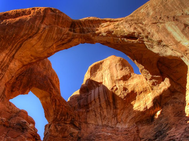 This high dynamic range image shows Double Arch, the largest natural arch in The Windows section at Arches.