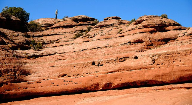 I move along a ridge above the Delicate Arch trail.