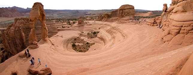 "Broad panorama of the Delicate Arch area, including the ""bowl"" below it. Note the flat lighting."