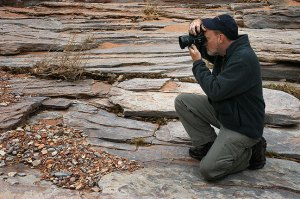 The author photographs the striated stream bed of Big Spring Canyon near the Confluence Overlook trail head at Canyonlands.