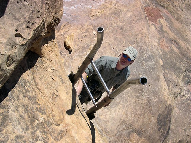 This image shows me descending one of the two ladders on the trail leading south out of Squaw Flat; this ladder is a little awkward because of the fact that it is canted outwards a bit.