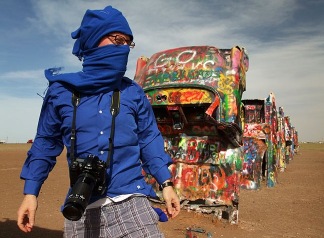 Robert uses the blue scarf as a prop with the Cadillacs and the driving wind.