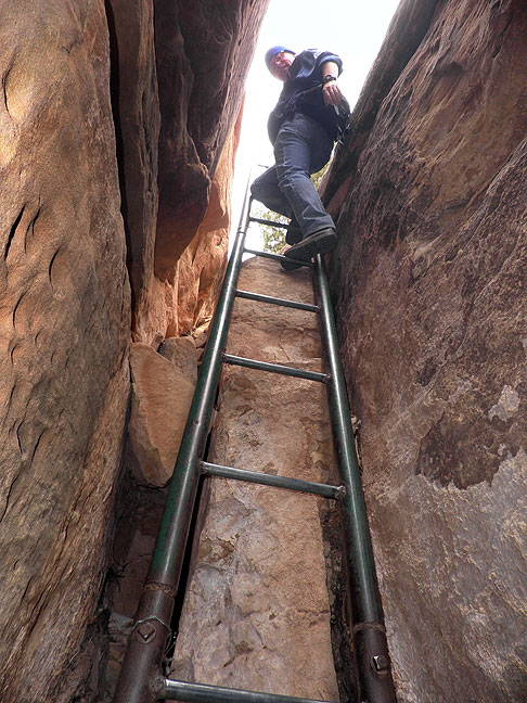 Robert descends the longer of the two ladders on the Peek-a-Boo trail; the Park Service suggests lowering larger backpacks with a rope on this ladder.