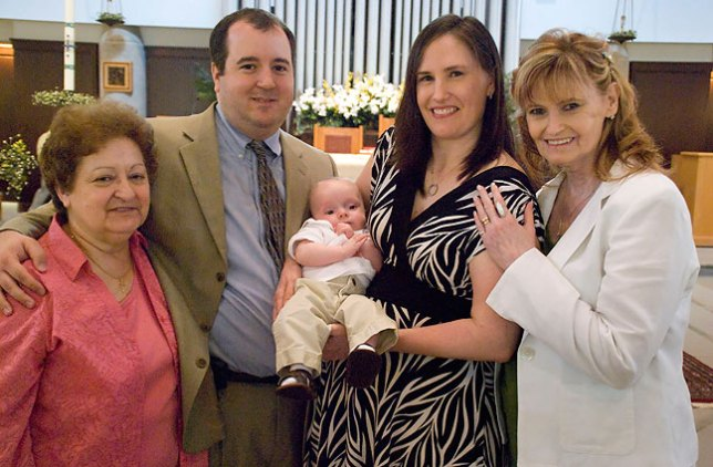 Tom and Chele with their mothers proudly hold Paul Thomas after his Christening.
