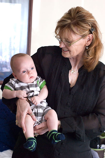 Abby holds our grandson. Although we love seeing him and his parents, it never seems like enough, and they seem too far away.