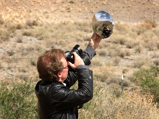 Robert uses a reflective chrome hub cap as he makes pictures near The Hogback in northwestern New Mexico.