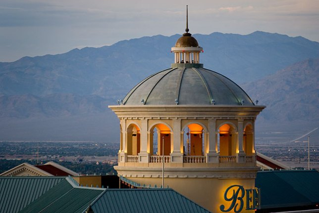 The crown of the Bellagio Hotel is set against the Quartzite Mountains at dusk.
