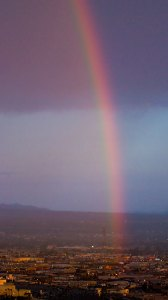 """Morning rainbow over Las Vegas; one presumes the """"end of the rainbow"""" is a casino."""