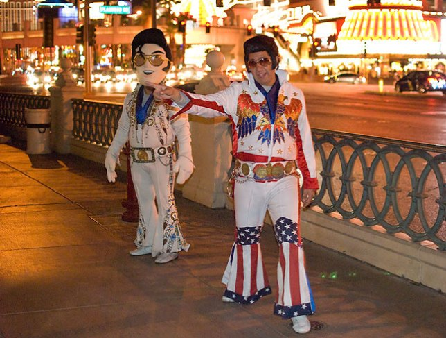 These two Elvis's (Elvi?) try to drum up money on The Las Vegas Strip.