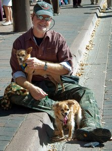 This is me on The Plaza in Santa Fe after I sat on a curb to take the dogs' sweaters off after it started to warm up.