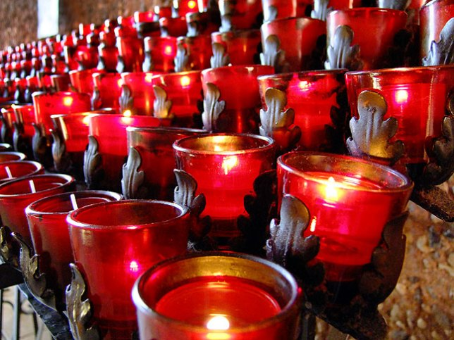 Small votive candles line the right hand wall of the Chapel.