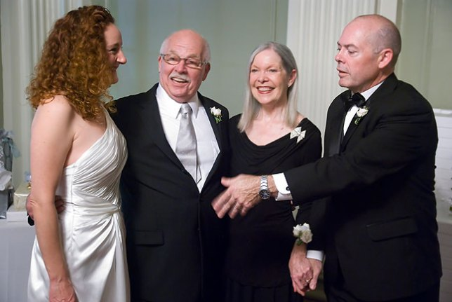 Tracey attempts to arrange a photo with his wife and parents.