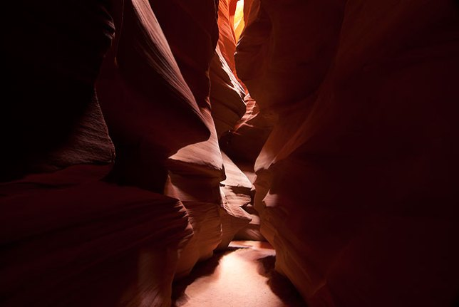 Only in rare moments like this is the floor of Antelope Canyon clear of people and tripod legs, allowing a clear shot. If and when it does happen, the beauty of the place is very powerful.