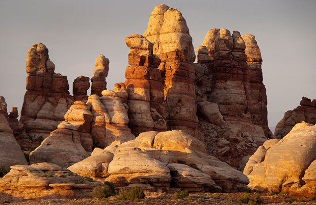The Doll House consists of the same Cedar Mesa Sandstone spires as are common in The Needles District of Canyonlands directly across the Colorado River.