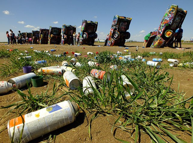 Stanley Marsh's Cadillac Ranch in Amarillo, Texas, was as crowded as I have ever seen it, and hundreds of empty paint cans were strewn in the field surrounding the cars.