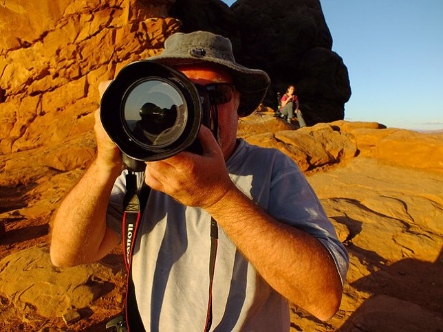 Jim photographs me photographing the South Window at Arches National Park...