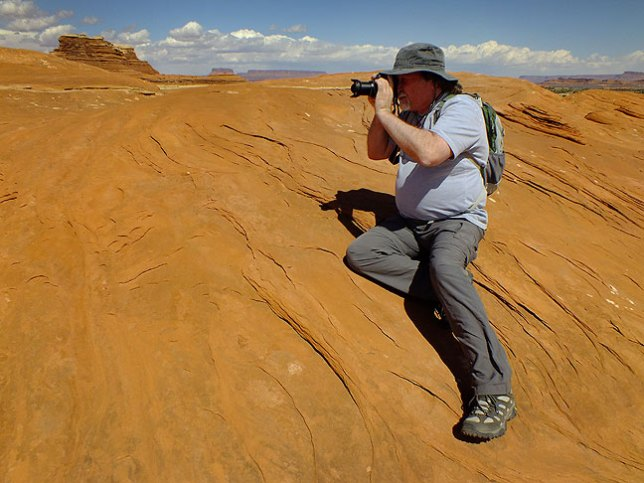 Jim gets an angle on a sandstone spire we found while exploring the Wooden Shoe Butte area at Canyonlands.