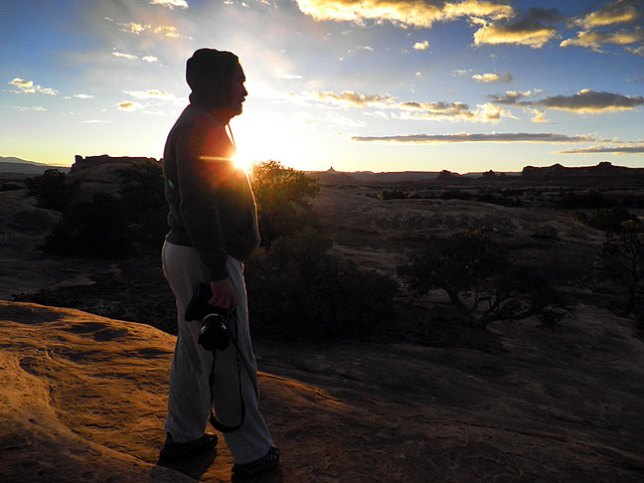 Jim tries to keep warm as he photographs first light at Squaw Flat campground at Canyonlands.