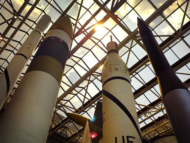 Various rockets stand on display at the Air and Space Museum.