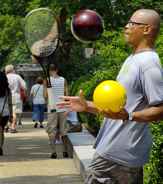 One of the few street performers we saw, this man juggles a volleyball, a bowling ball, and a tennis racket.