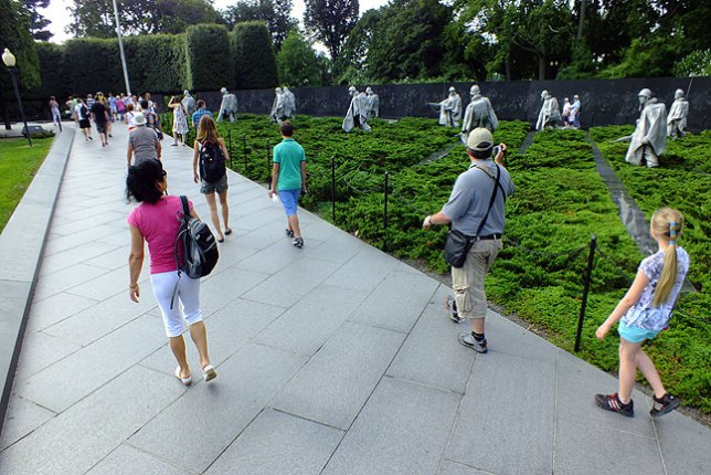 Approaching the Korean War Memorial, visitors appear to walk alongside the soldiers depicted.
