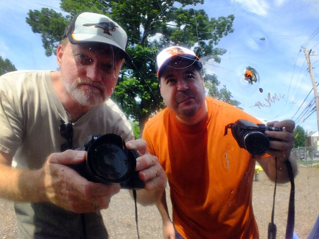 Tom and I photograph ourselves in a mirror at a playground where we took Paul to play.
