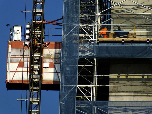 This close-up of the Washington Monument shows workers and an elevator used for repairs. The attraction was damaged in the August 23, 2011 Virginia earthquake.
