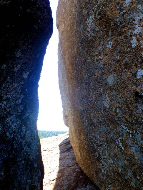 Granite boulders form cracks large enough for an adult to traverse.