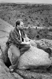 David Martin rests during a hike near Bat Cave Mountain, 1995.