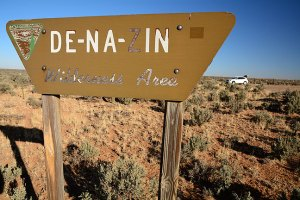 This trailhead sign at the De-Na-Zin Wilderness is weathered, and faces the road, so it's easy to miss.