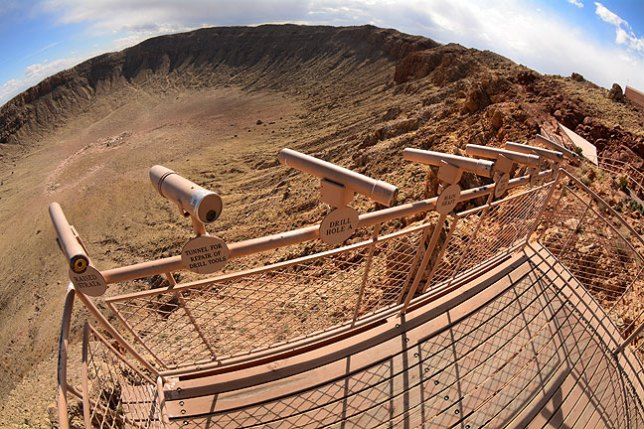 Spotting scopes sit mounted on a visitor's platform overlooking Meteor Crater in Arizona.