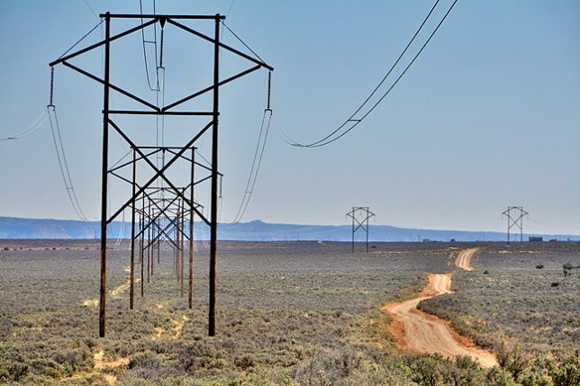 A road and power lines lead into the distance near the De-Na-Zin Wilderness.