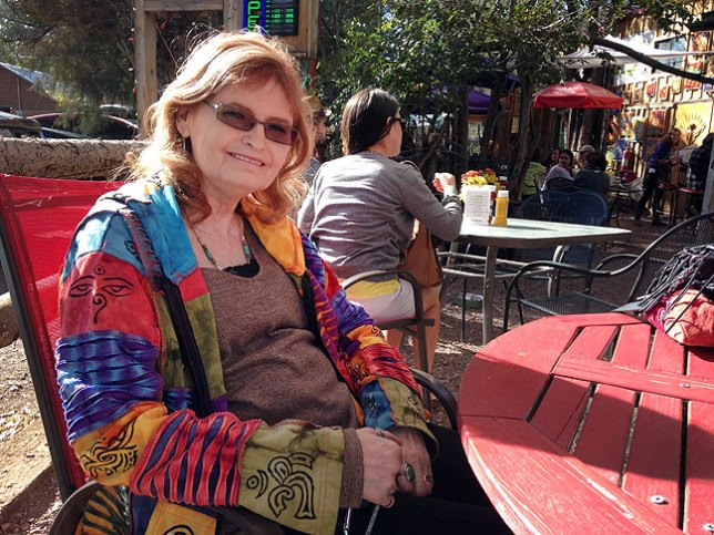 """Abby smiles at an outdoor café, The Hollar, in Madrid, New Mexico. """"I could live here,"""" she said."""