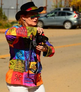 Abby takes aim at the cattle drive we spotted going through downtown Mancos, Colorado.