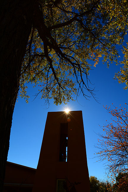 Just steps away from the mirror I photographed in Arroyo Seco, I spotted the afternoon sun peeking over this church.
