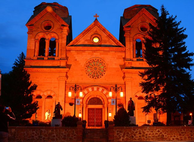 I photographed the Cathedral Basilica of St. Francis of Assisi on the Plaza at Santa Fe just after sunset, showing some remaining blue sky. Compare to...